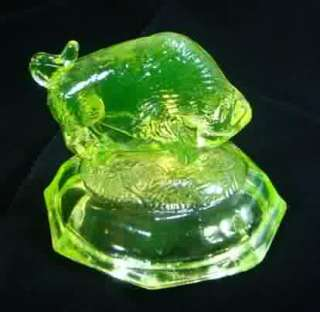 Yellow Vaseline Glass Buffalo, Bison Paperweight standing on a mound